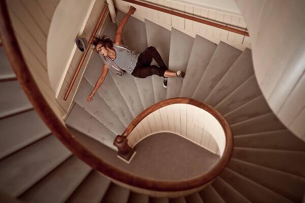 Woman fallen on staircase